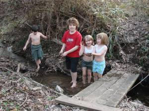 Children enjoying a typical neighborhood stream.
