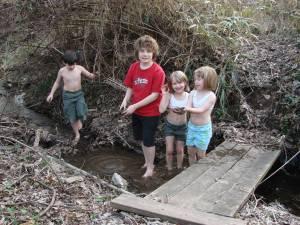 Children enjoying a typical neighborhood stream.